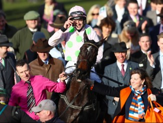 Ruby Walsh celebrates winning the Mares' Hurdle on Benie Des Dieux