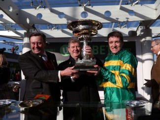 Nicky Henderson (left), JP McManus and Barry Geraghty (right) after Buveur D'Air's second Champion Hurdle
